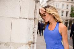 young woman out of breath from running - stock photo