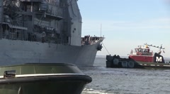 USA Virgina Norfolk, November 2015, shoulder close-up USS Anzio Drive Tugboats - stock footage