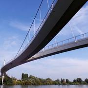 Low angle view of suspended bridge on river, blue sky Stock Photos
