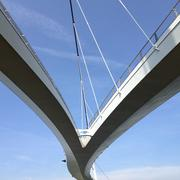 Upward view of suspended bridge against blue sky Stock Photos