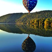 Hot air balloon over a lake in Auvergne, France Stock Photos