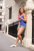 Fitness woman having a break and drink of water Stock Photos