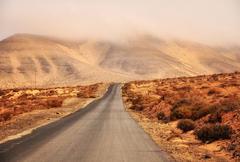 Empty road, Jandia, Fuerteventura, Canary Islands, Spain Stock Photos