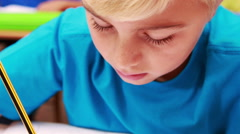 Cute little boy drawing with a pencil Stock Footage