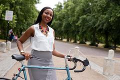 Young woman in the park with her bike Stock Photos