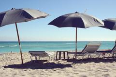 Sun loungers and beach umbrellas, South Beach, Florida, USA Stock Photos