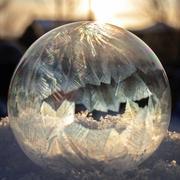 A soap bubble freezing in sun Stock Photos