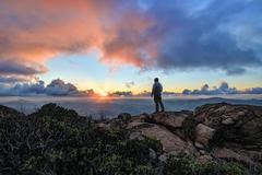 Mature man standing on a mountain at sunset, Cleveland National Forest, USA Kuvituskuvat