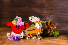 Composition of Christmas decoration  reindeer and Santa sleigh with gifts, br Kuvituskuvat