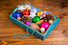 Vintage wooden box with Christmas decoration, tinsel,  pinecones, stars and b Stock Photos
