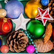 top view of Christmas decoration, tinsel,  pinecones, stars and balls like  b - stock photo
