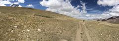 Walking slowly up to Kongmarula, high altitude pass in Ladakh, India - stock photo