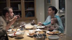 Young husband yelling at his with with child during dinner at home HD Stock Footage