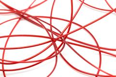 Stock Photo of red wire on a white background