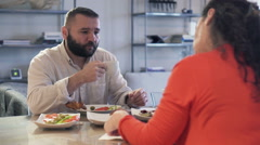 Bored, resentful couple sitting by the table during breakfast HD Stock Footage