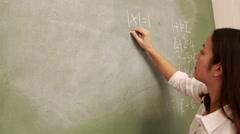 Stock Video Footage of Teacher writing on blackboard