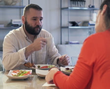 Bored, resentful couple sitting by the table during breakfast PAL Stock Footage