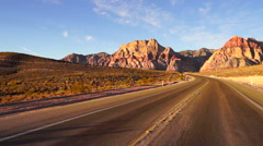 Two Lane Highway Leads to Red Rock Canyon Las Vegas USA Stock Footage