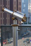 Telescope overlooking for city streets from above - stock photo