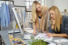 Fashion Stylists Working on New Design on a Paper Stock Photos
