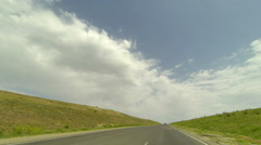 Clouds over the road. Balykleyskoe village, Volgograd region, Russia, Full HD Stock Footage