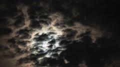Full Moon Rising through orange clouds time lapse Stock Footage