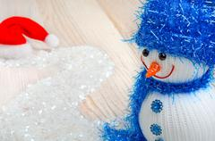 Snowman on the background of Christmas snow - stock photo