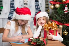 Happy children preparing for New Year and Christmas celebration Stock Photos