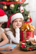 Stock Photo of Happy children preparing for New Year and Christmas celebration
