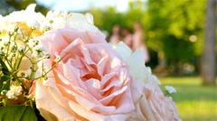 Defocused figures of bride and bridesmaids on the background - stock footage