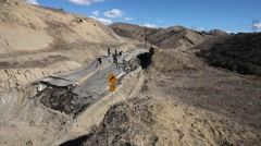 Vasquez canyon landslide and road damage ground view - stock footage