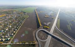 Aerial road interchange, viaduct. Crossroads view parking lots, bridges. Copter Stock Photos
