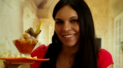 Brunette holding up plate with delicious fish ceviche and smiling to camera Stock Footage