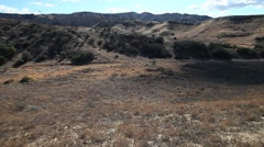 Vasquez canyon landslide terrain and road closure barriers Stock Footage