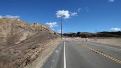 Vasquez canyon landslide buckles road, static wide shot Stock Footage