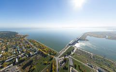 Aerial water power plant view with crossroads and roads, civil  buildings Stock Photos