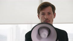 White Collar Office Worker Talking With Megaphone At Camera Stock Footage