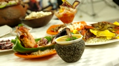 Beautiful seafood selection spread out on table with camera sliding past Stock Footage