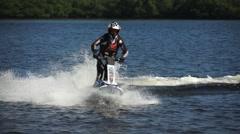 Rider circles on a jet ski Stock Footage