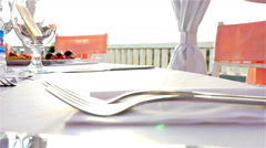 Hand putting a plate with starter on a table in a restaurant - stock footage