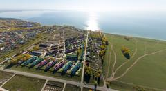 Aerial view of a summer house village at blue sea coast - stock photo