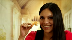 Attractive brunette taking a bite of a prawn and smiling to camera Stock Footage