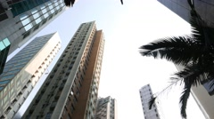 Typical perspective while look up at Hong Kong, match like buildings rise high Stock Footage