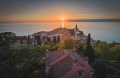Sunset Over Adriatic Sea and Old Town of Piran, Slovenia - stock photo