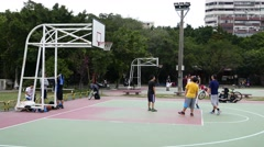 Amateur basketball game at public park playground, successful throw Stock Footage
