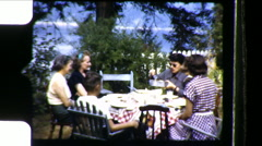 People Family Eat Meal Outdoors Garden Picnic Vintage Film Home Movie 8651 Stock Footage