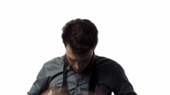 Young Adult who does not know how to Tie a Bow Tie. Stock Footage