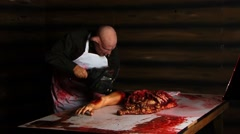 Haunted House Scary horror pig man at table with chainsaw 3 - stock footage
