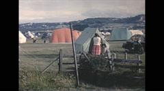Vintage 16mm film, 1965, UK, campsite tents and caravans Stock Footage