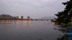 Night view, twilight Taipei Sinbay skyline, Tamsui river side pan shot Stock Footage